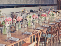 wooden furniture at rustic wedding reception