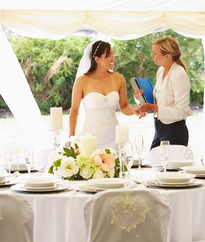 Bride talking with wedding planner