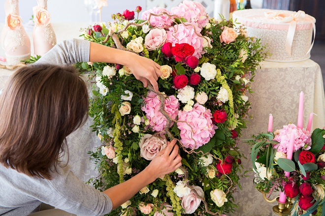 wedding planner working on reception decorations