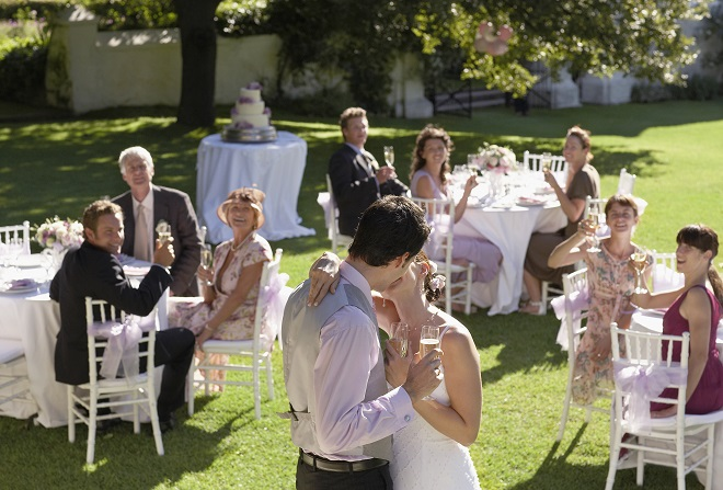 wedding guests toasting newlyweds at adult only reception
