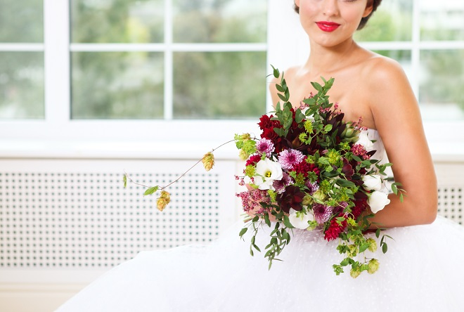 bride holding striking wedding flowers