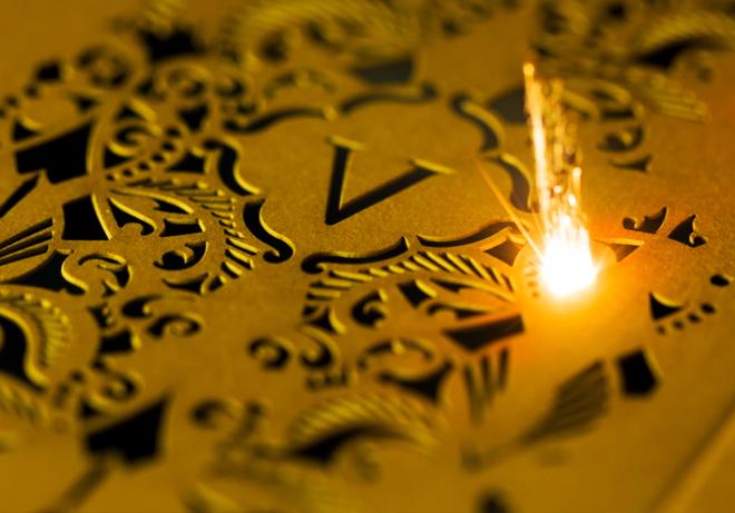 Laser cutting shapes into a wedding card