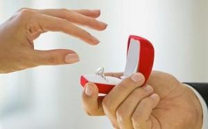 Man extending engagement ring to girlfriend