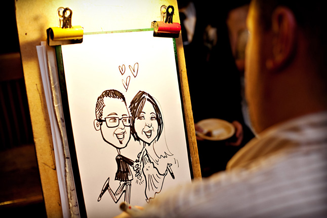 caricaturist entertaining guests at wedding