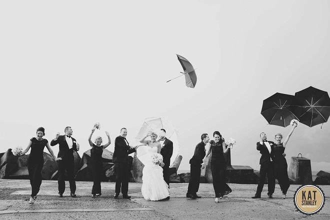 bridal couple braving the weather for photos