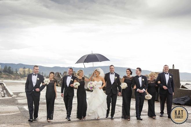 bridal party braving rain