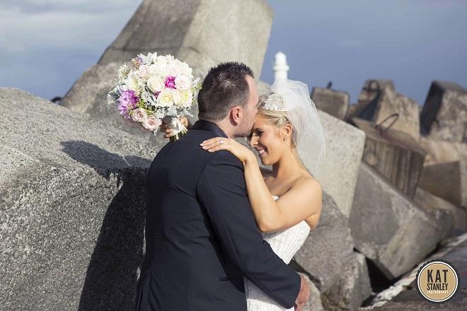 sweet kiss between bride and groom