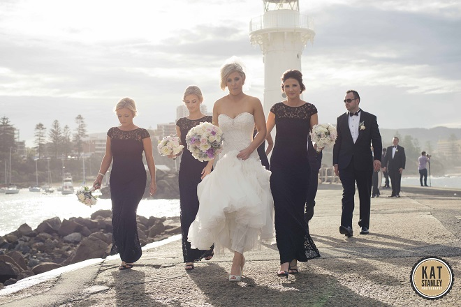 real wedding photos of bridal party by the sea