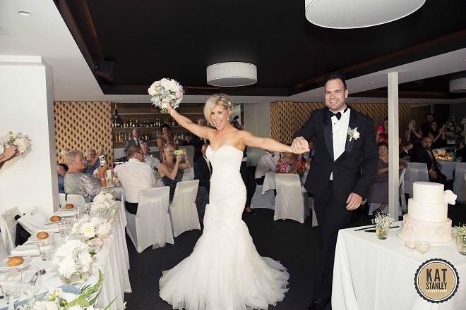 bride and groom entering wedding reception venue