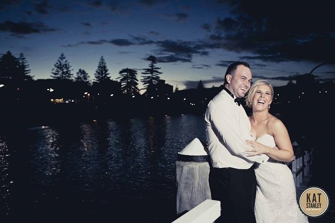 bride and groom pose after wedding reception