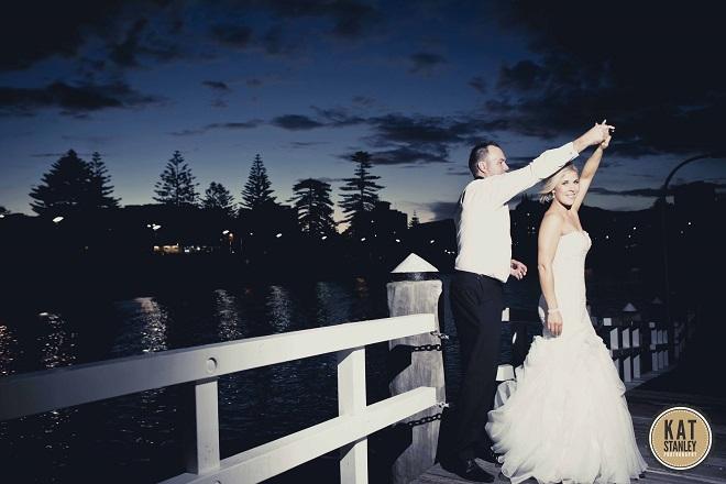 bridal couple dance on harbour