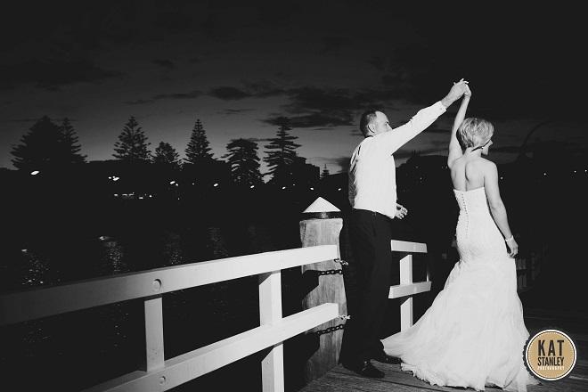 groom spins bride around dancing at real wedding
