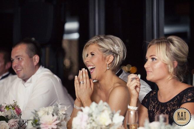 bride listening to wedding toasts