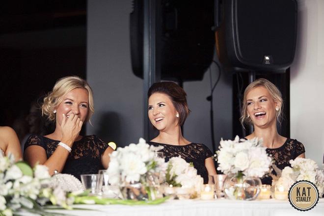 bridesmaids listening to wedding speeches