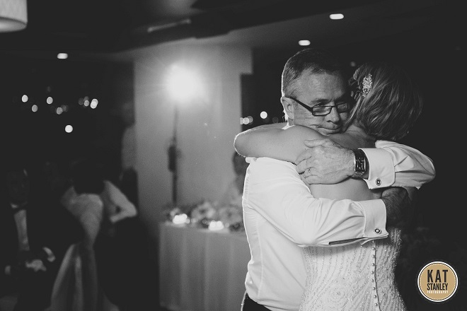 bride shares a moment with father at wedding
