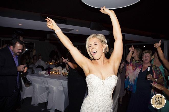 bride celebrating at wedding reception