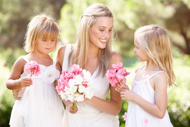 bride with multiple flower girls