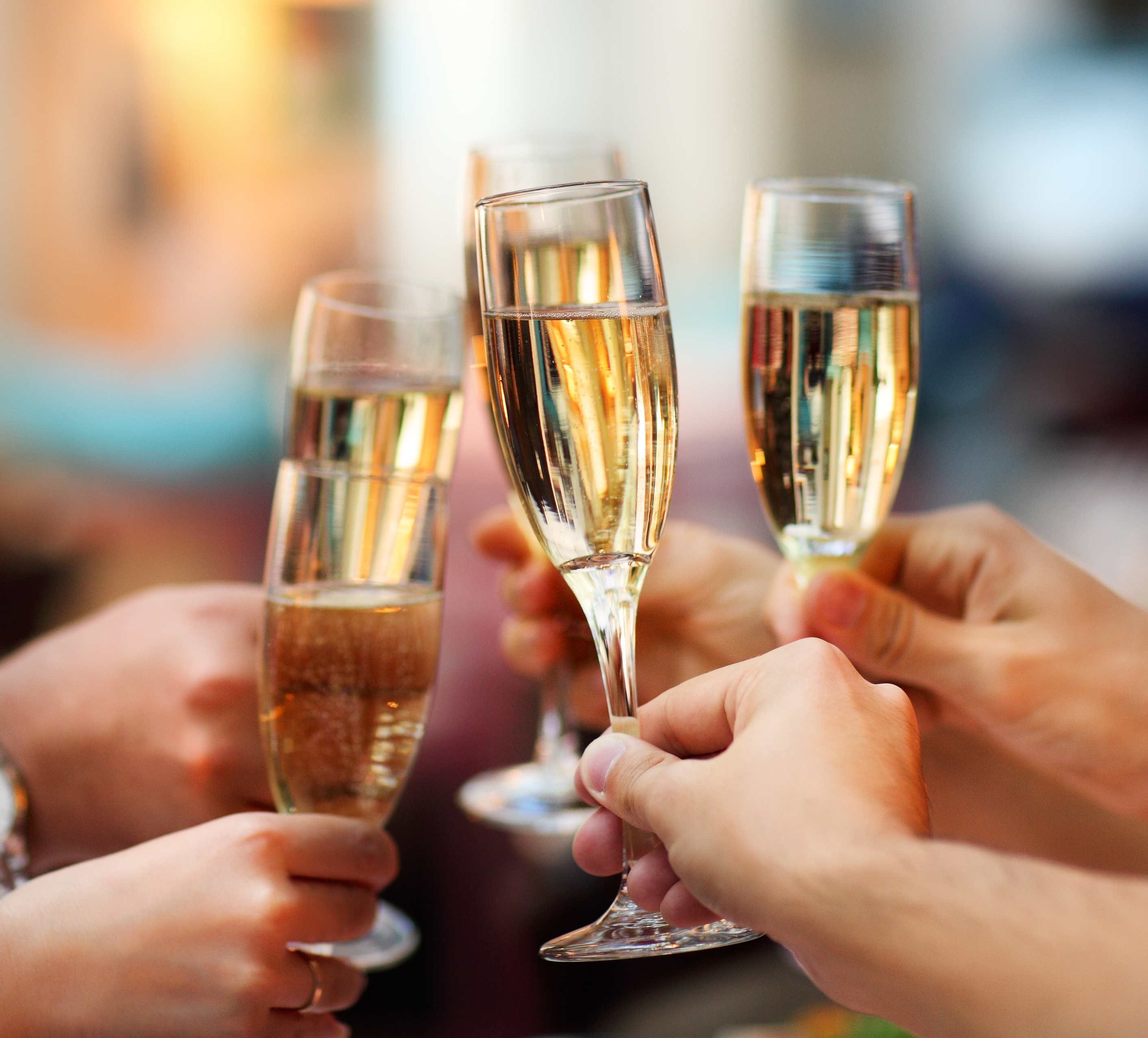 bride and bridesmaids toasting as part of wedding timeline