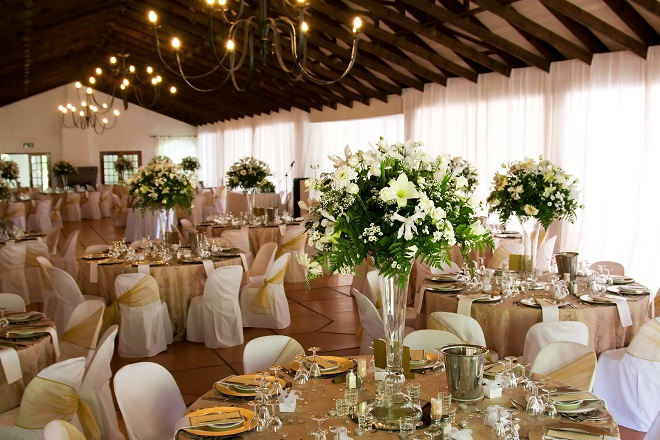 wedding venue for reception styled with white flowers