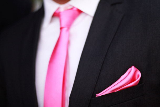 groom wearing pink tie for wedding