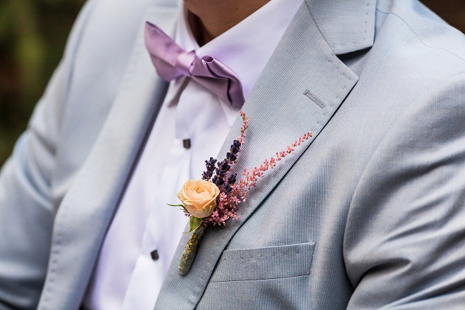 Close up of grooms suit and wedding boutonniere