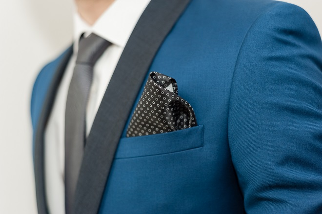 close up of grooms suit and pocket square accessory