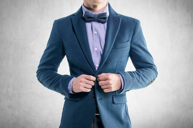 young groom sporting a casual bow tie wedding attire style