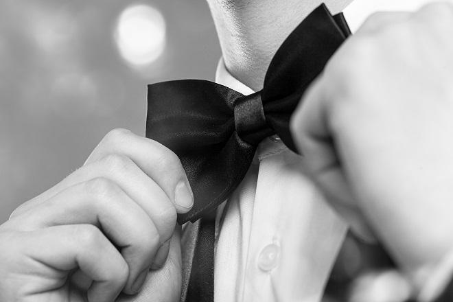 close up of wedding attire for groom via bow tie