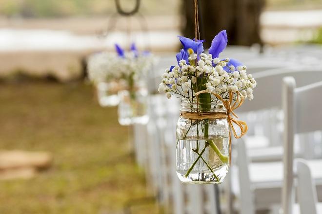 wedding ceremony decoration withflowers hanging in mason jar