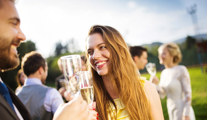 Engagement party guests clinking glasses