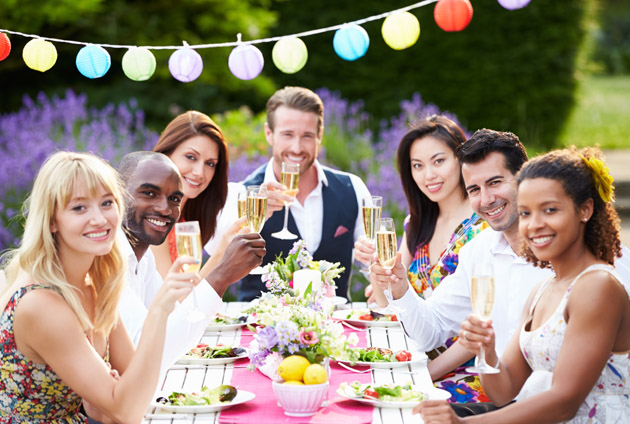 Group Of Friends Enjoying Outdoor Engagement Party