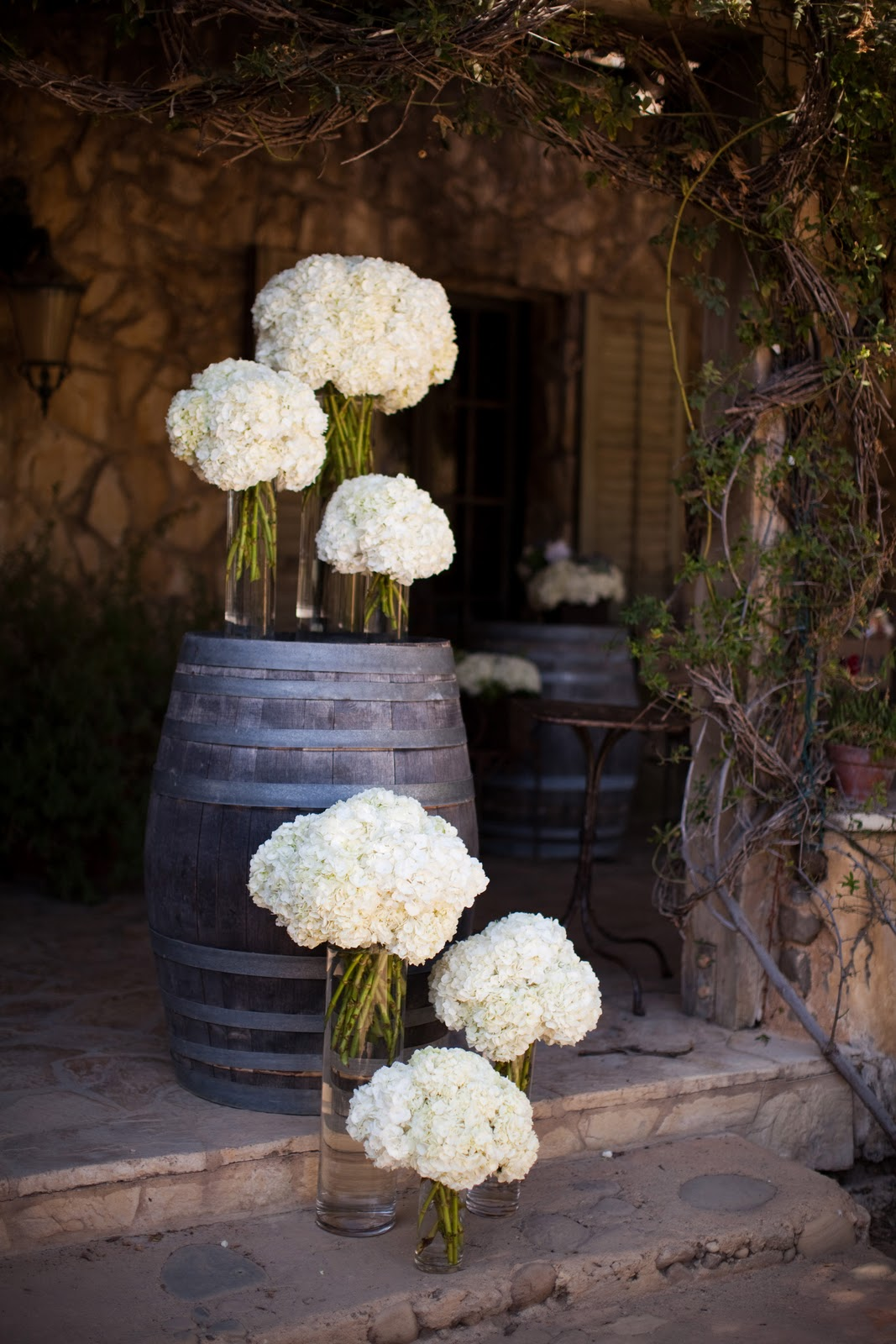 rustic ceremony decor wine barrels
