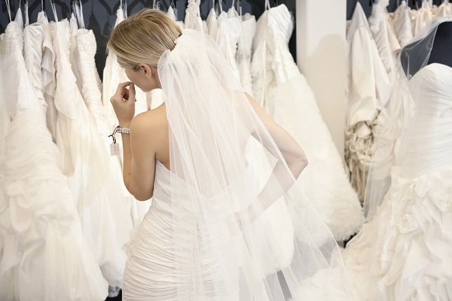 bride browsing gowns at wedding dress shops