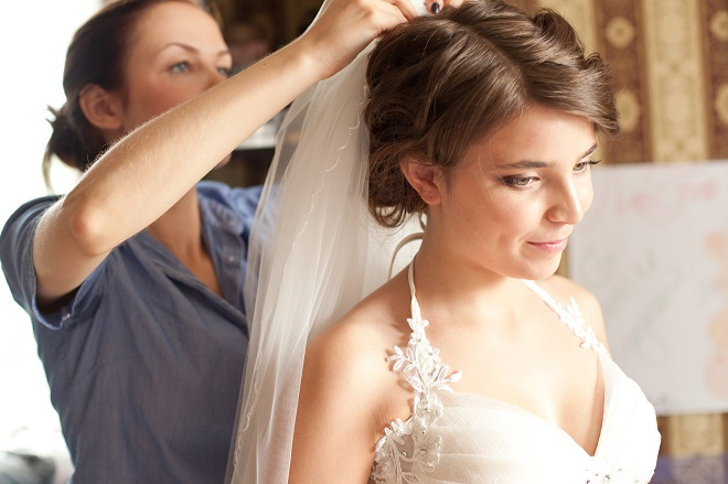 wedding planner helping bride get ready