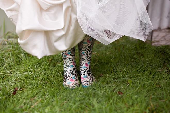 bad weather at wedding bride wears gumboots