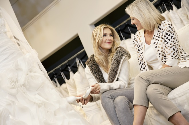 mother of the bride wedding dress shopping with daughter