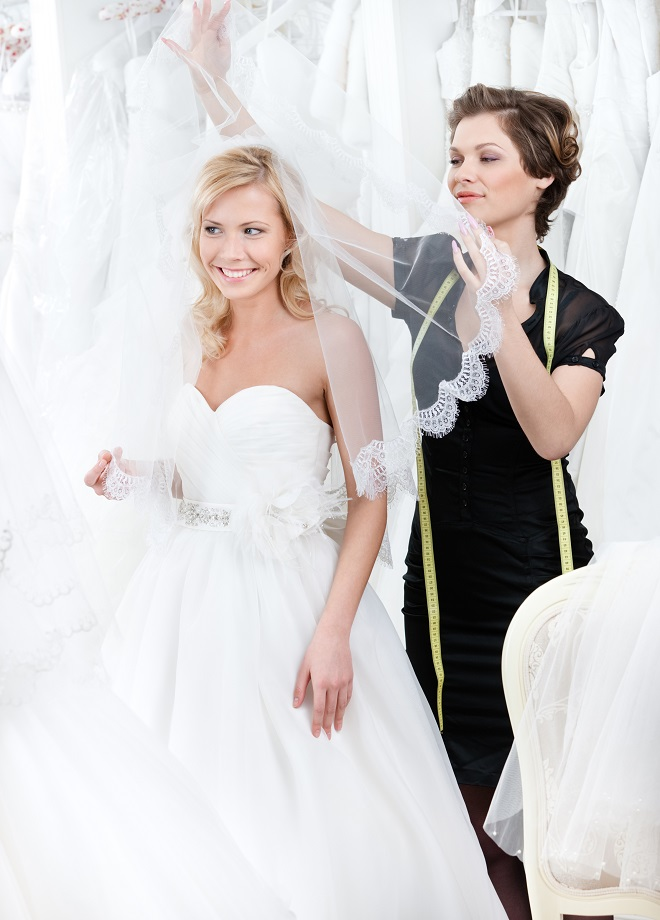 bride trying on bridal gown
