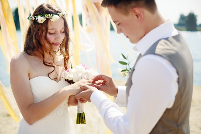bride and groom exchange personal wedding vows