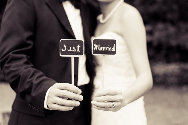 bridal holding just married sign signalling need forchanging name after marriage