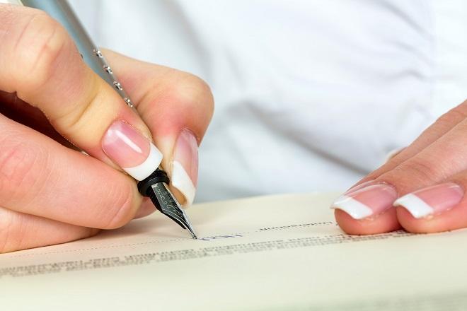 woman signing change of name