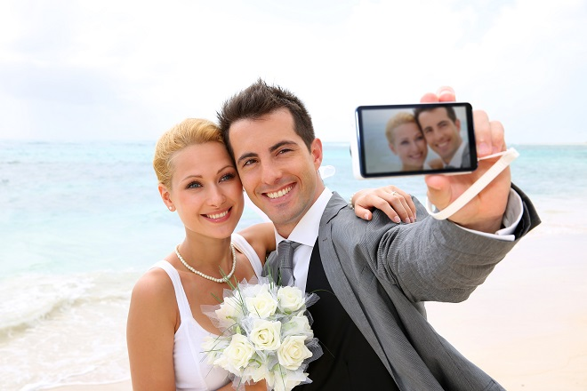 bride and groom taking a picture of themselves