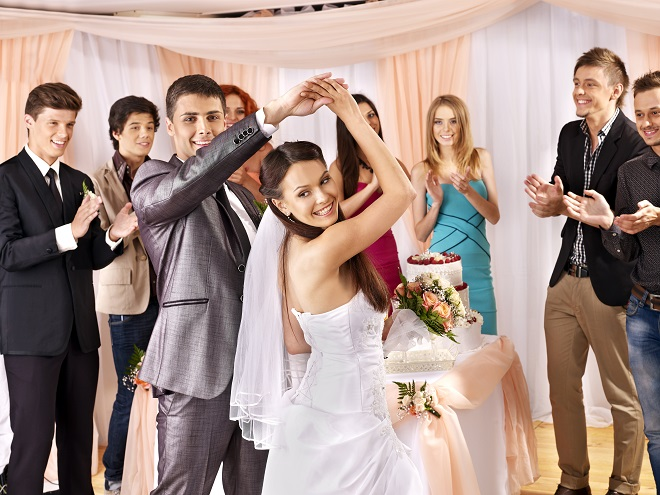 dancing wedding guests with bride and groom