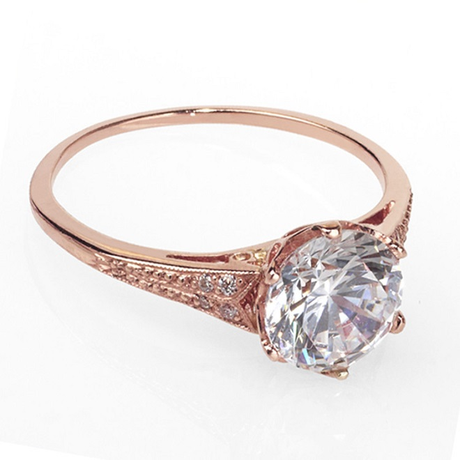 vintage rose gold diamond engagement ring with round brilliant cut