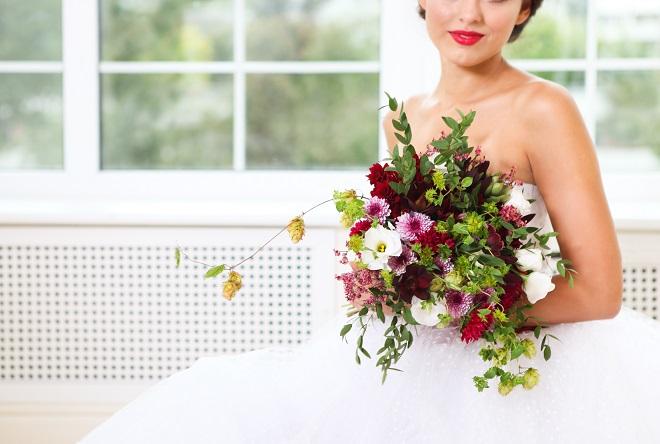 bride holding striking wedding flowers