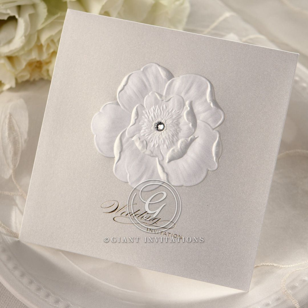 Swarovski accented floral wedding invitation with sculted design, raised ink and gold foil stamp