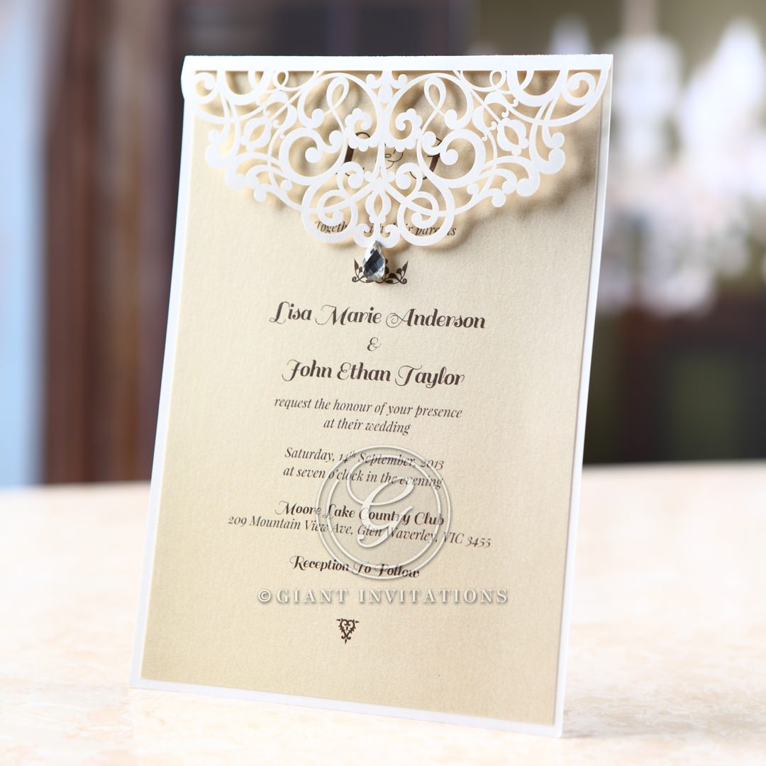 Swarovski design on white laser cut flap pocket invitation