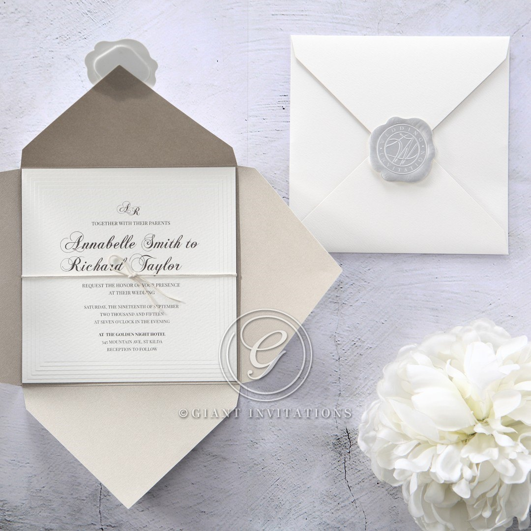 Classic white inner card with embossed border, bound by a dainty string, inserted in a white textured pocket with silver stamp