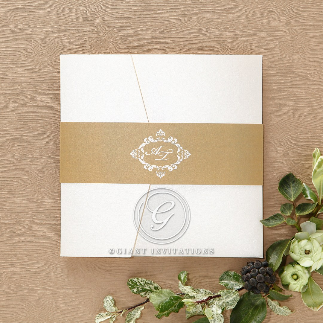 Shiny gold belly band, with custom initials, wrapped around a white pocket invite