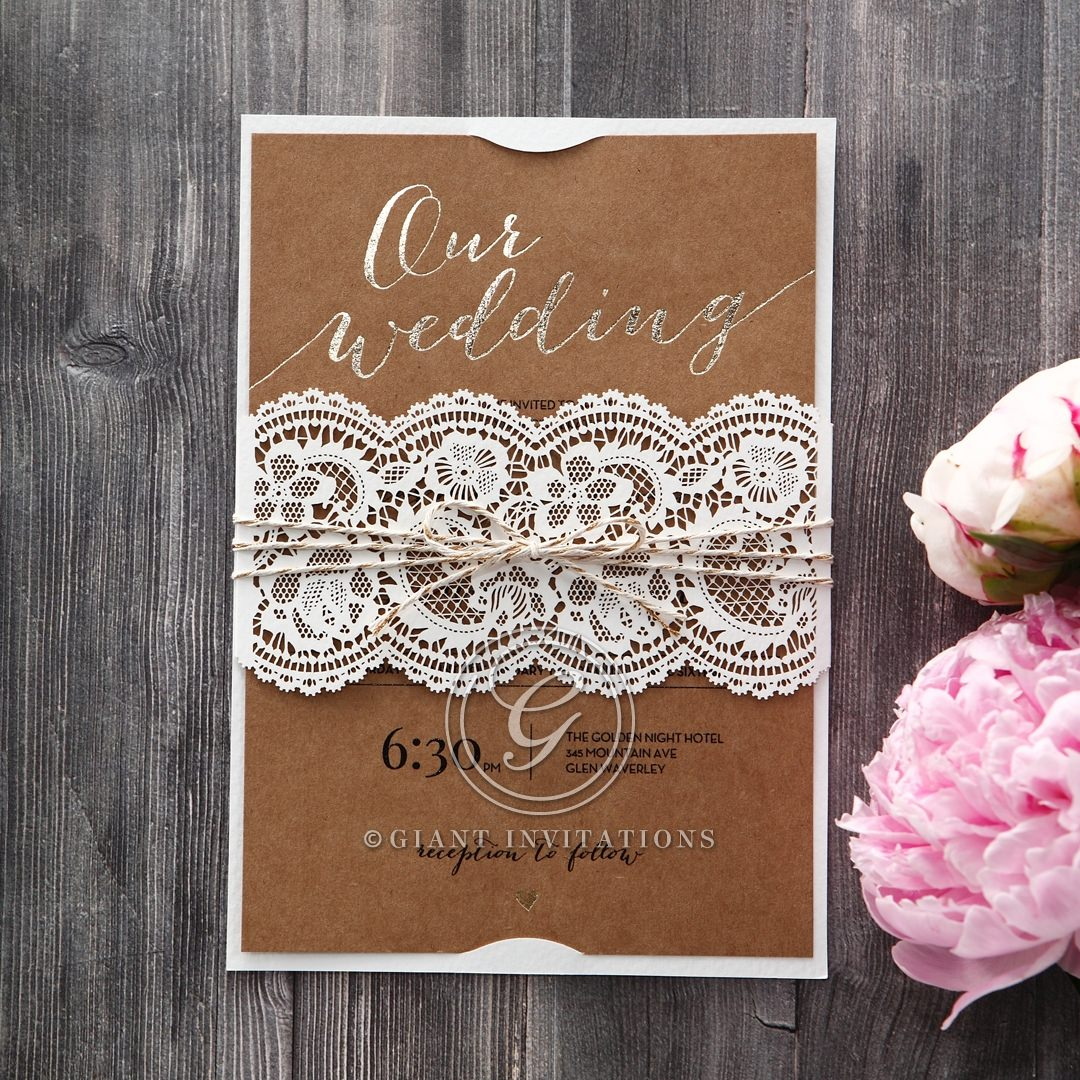 White pocket with lace patterned lasercut sleeve enclosing a brown craft card with gold foil print, bound by twine