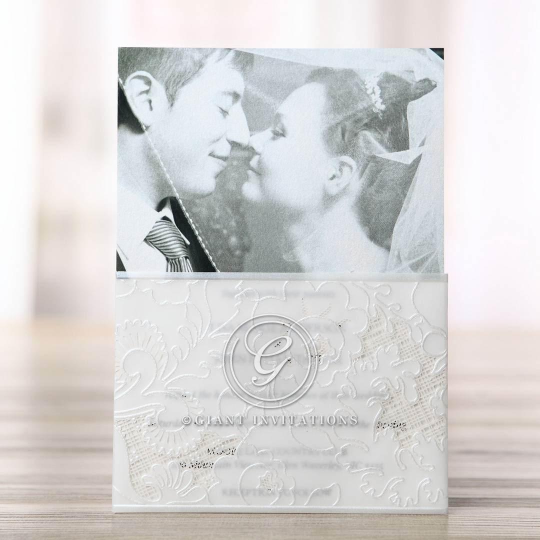 Silkscreened embossed photo invitation, white sleeve, folded, thermography